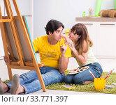 Купить «Young couple enjoying painting at home», фото № 33771397, снято 11 июля 2018 г. (c) Elnur / Фотобанк Лори