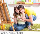 Купить «Young couple enjoying painting at home», фото № 33771401, снято 11 июля 2018 г. (c) Elnur / Фотобанк Лори
