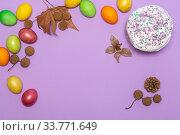 Купить «location of Easter cake and painted eggs on a lilac background», фото № 33771649, снято 12 апреля 2020 г. (c) Иванов Алексей / Фотобанк Лори