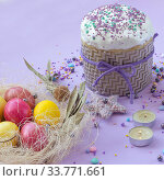 Easter cake and painted eggs beautifully decorated on a lilac background. Стоковое фото, фотограф Иванов Алексей / Фотобанк Лори