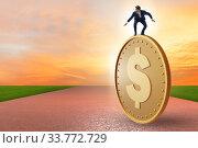 Купить «Businessman with giant golden dollar coin», фото № 33772729, снято 5 июня 2020 г. (c) Elnur / Фотобанк Лори