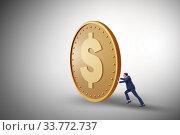 Купить «Businessman with giant golden dollar coin», фото № 33772737, снято 5 июня 2020 г. (c) Elnur / Фотобанк Лори
