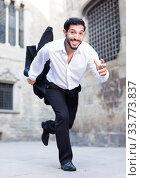 Expressive man running past old city. Стоковое фото, фотограф Яков Филимонов / Фотобанк Лори