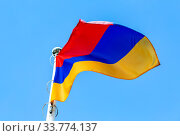 Купить «National flag of Armenia waving in the wind against the sky», фото № 33774137, снято 7 сентября 2019 г. (c) FotograFF / Фотобанк Лори