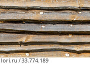 Купить «Rough wooden boards with cracks as background», фото № 33774189, снято 11 мая 2019 г. (c) FotograFF / Фотобанк Лори