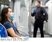Купить «Female passenger in personal protective equipment traveling in subway during the COVID-19 pandemic», фото № 33775297, снято 27 мая 2020 г. (c) Яков Филимонов / Фотобанк Лори