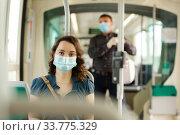 Woman in medical mask sitting in streetcar. Стоковое фото, фотограф Яков Филимонов / Фотобанк Лори