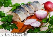 Купить «Marinated mackerel with sliced onion and parsley», фото № 33775481, снято 28 мая 2020 г. (c) Яков Филимонов / Фотобанк Лори