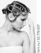 Купить «Black and white portrait in high key tone female with creative hairdo braids», фото № 33776037, снято 30 января 2012 г. (c) Serg Zastavkin / Фотобанк Лори