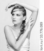 Купить «Black and white portrait in high key tone female with creative hairdo braids», фото № 33776089, снято 30 января 2012 г. (c) Serg Zastavkin / Фотобанк Лори