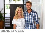 Купить «Portrait of Caucasian couple enjoying their time at the house», фото № 33776337, снято 19 февраля 2020 г. (c) Wavebreak Media / Фотобанк Лори