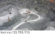 Aerial video view of mining quarry. Excavator loads rock in a dump truck. Стоковое видео, видеограф Serg Zastavkin / Фотобанк Лори