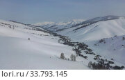 Купить «Aerial video view from drone on winter snow landscape natural background. Altai, Siberia, Russia», видеоролик № 33793145, снято 9 марта 2020 г. (c) Serg Zastavkin / Фотобанк Лори