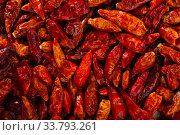 Купить «Red cayenne peppers on wooden surface», фото № 33793261, снято 25 мая 2020 г. (c) Яков Филимонов / Фотобанк Лори