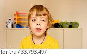 Купить «Adorable little boy tells about herself on camera», фото № 33793497, снято 11 июля 2020 г. (c) Ekaterina Demidova / Фотобанк Лори