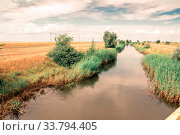 Купить «A large artificial canal filled with water for irrigation of fertile land.», фото № 33794405, снято 9 июля 2013 г. (c) Акиньшин Владимир / Фотобанк Лори