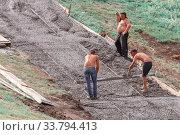 Купить «Russia, Samara, August 2017: workers builders make a ladder of concrete leading to the temple.», фото № 33794413, снято 12 августа 2017 г. (c) Акиньшин Владимир / Фотобанк Лори