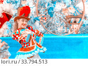 """Russia Samara August 2018: Clowness in a bright costume on the procession """"Flower Festival"""" Редакционное фото, фотограф Акиньшин Владимир / Фотобанк Лори"""