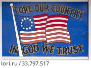 Купить «Wall Mural of an Earlier Prototype of the American Flag with the Phrase 'In God We Trust' Located Along Westheimer Road, Houston, Texas, United States of America», фото № 33797517, снято 20 апреля 2020 г. (c) age Fotostock / Фотобанк Лори