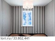 Купить «Empty room with a window and striped wall-paper», фото № 33802441, снято 6 июня 2020 г. (c) age Fotostock / Фотобанк Лори