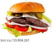 Купить «Double cheeseburger with beef, tomato, cheese, cucumber and lettuce», фото № 33804261, снято 10 июля 2020 г. (c) Яков Филимонов / Фотобанк Лори