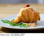 Купить «Camembert on top of mini croissant», фото № 33804297, снято 27 мая 2020 г. (c) Яков Филимонов / Фотобанк Лори