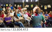 Female academic professor lecturing at scientific public event. Стоковое фото, фотограф Matej Kastelic / Фотобанк Лори