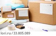 Купить «parcel boxes on table at post office», видеоролик № 33805089, снято 27 мая 2020 г. (c) Syda Productions / Фотобанк Лори
