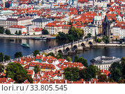 Panoramic view from above of Prague, Charles bridge with crowds of tourists, the Vltava river and red roofs. Czech Republic (2014 год). Стоковое фото, фотограф Наталья Волкова / Фотобанк Лори