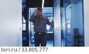 Купить «Businessman celebrating in modern office», видеоролик № 33805777, снято 12 октября 2019 г. (c) Wavebreak Media / Фотобанк Лори