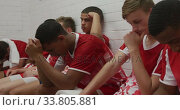 Depressed rugby players in the locker room. Стоковое видео, агентство Wavebreak Media / Фотобанк Лори