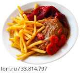 Купить «Image of baked pork cheeks in sauce with potatoes fri and stew vegetables served on plate», фото № 33814797, снято 5 июля 2020 г. (c) Яков Филимонов / Фотобанк Лори