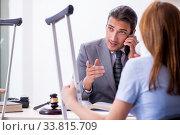 Купить «Young injured woman and male lawyer in the courtroom», фото № 33815709, снято 22 октября 2019 г. (c) Elnur / Фотобанк Лори