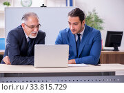 Купить «Yound and old employees in business presentation concept», фото № 33815729, снято 21 октября 2019 г. (c) Elnur / Фотобанк Лори