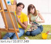 Купить «Young couple enjoying painting at home», фото № 33817349, снято 11 июля 2018 г. (c) Elnur / Фотобанк Лори