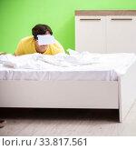 Купить «Young man with virtual glasses in the bedroom», фото № 33817561, снято 22 июня 2018 г. (c) Elnur / Фотобанк Лори
