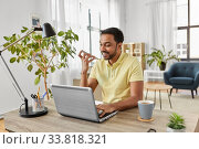 man with laptop recording voice on phone at home. Стоковое фото, фотограф Syda Productions / Фотобанк Лори