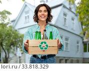 Купить «smiling young woman sorting glass waste outdoors», фото № 33818329, снято 18 апреля 2020 г. (c) Syda Productions / Фотобанк Лори