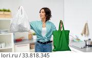 Купить «woman with plastic and reusable shopping bag», фото № 33818345, снято 18 апреля 2020 г. (c) Syda Productions / Фотобанк Лори