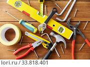 Купить «different work tools on wooden boards background», фото № 33818401, снято 26 ноября 2019 г. (c) Syda Productions / Фотобанк Лори