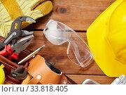 Купить «different work tools in belt on wooden boards», фото № 33818405, снято 26 ноября 2019 г. (c) Syda Productions / Фотобанк Лори