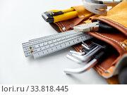Купить «different work tools in belt on white background», фото № 33818445, снято 26 ноября 2019 г. (c) Syda Productions / Фотобанк Лори