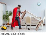 Купить «Super hero cleaner working at home», фото № 33818585, снято 22 декабря 2016 г. (c) Elnur / Фотобанк Лори