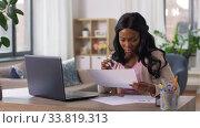 Купить «stressed woman with papers working at home office», видеоролик № 33819313, снято 16 мая 2020 г. (c) Syda Productions / Фотобанк Лори