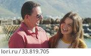 Купить «Front view of a Caucasian man and his teenage daughter enjoying time harbor side», видеоролик № 33819705, снято 4 февраля 2020 г. (c) Wavebreak Media / Фотобанк Лори