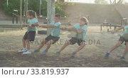 Купить «Group of Caucasian children training at boot camp », видеоролик № 33819937, снято 7 февраля 2020 г. (c) Wavebreak Media / Фотобанк Лори