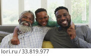 Купить «Mixed race man spending time with his father and his son», видеоролик № 33819977, снято 19 февраля 2020 г. (c) Wavebreak Media / Фотобанк Лори
