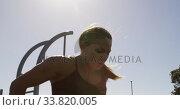 Купить «Sporty Caucasian woman exercising in an outdoor gym during daytime», видеоролик № 33820005, снято 8 августа 2019 г. (c) Wavebreak Media / Фотобанк Лори