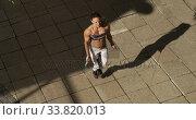 Купить «Sporty Caucasian woman exercising outdoor», видеоролик № 33820013, снято 8 августа 2019 г. (c) Wavebreak Media / Фотобанк Лори