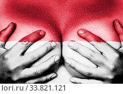 Купить «Sweaty upper part of female body, hands covering breasts, flag of Indonesia», фото № 33821121, снято 5 июня 2020 г. (c) age Fotostock / Фотобанк Лори